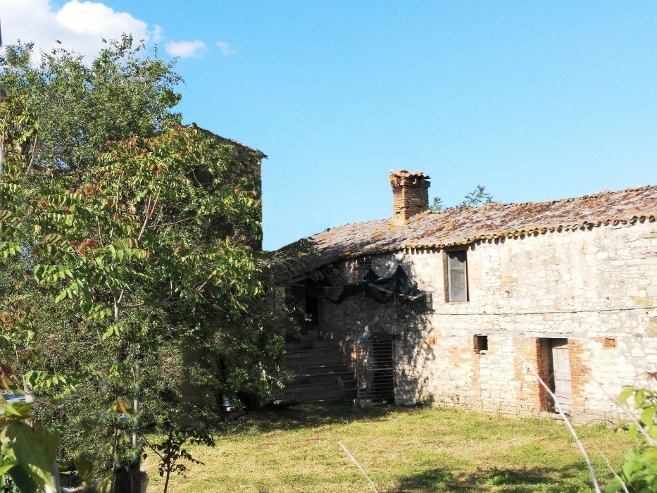 Old stone farmhouse with outbuildings